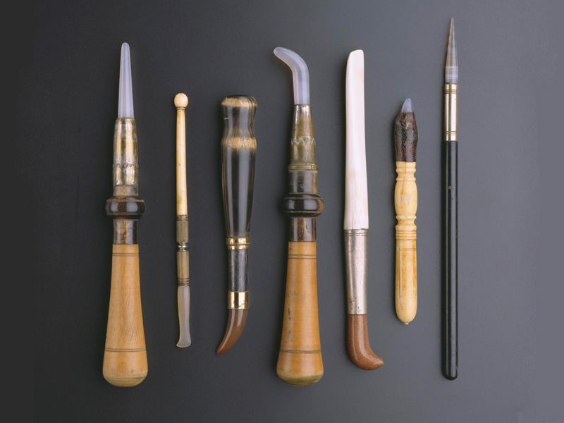 Gold burnishers. Turkey, 1800s. Tips of agate or tiger's-eye; silver or base metal sleeves connecting tips to handles made of fruit wood, ebony, and ivory. Lengths range from 7.6 to 4.8 in. (194. to 12.1 cm). Private collection