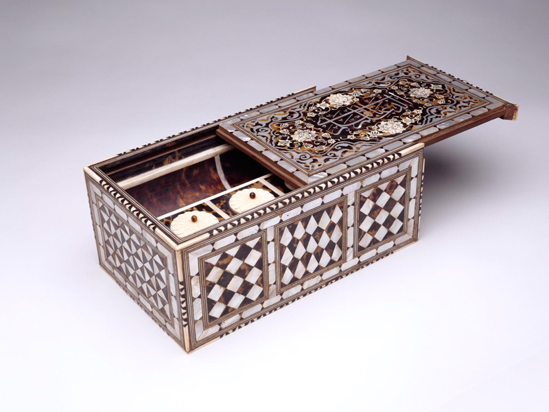 """Calligrapher's storage box bearing the Qur'anic (96:4) inscription """"Who taught by the pen."""" Turkey, 1700s. Wood, inlaid with tortoiseshell (over gold leaf), ivory, brass, mother-of-pearl, and bone. 5.7 x 12.9 x 8 in. (14.4 x 35.2 x 20.2 cm). Private collection"""
