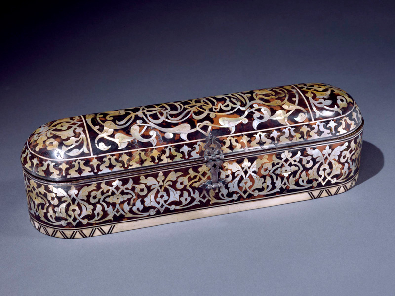 """Pen box bearing the inscription """"In the name of God, the Compassionate, the Merciful."""" Turkey, 1700s. Wood with tortoiseshell and mother-of-pearl inlay; interior lined with leather. 14.5 x 14 x 4.1 in. (11.4 x 35.6 x 10.5 cm). Private collection"""